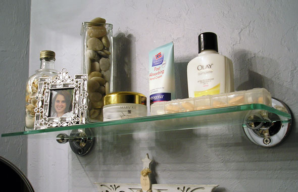 Bathroom sink shelf