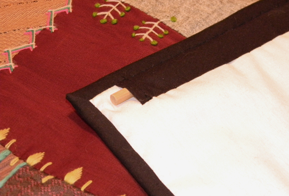 I used the tape for the binding around all the edges, and the rod sleeve to hang it with using a small dowel rod.