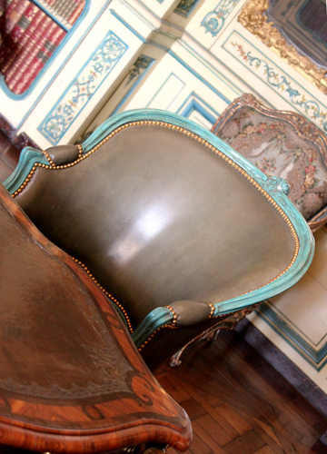 Turquoise-trimmed taupe chair
